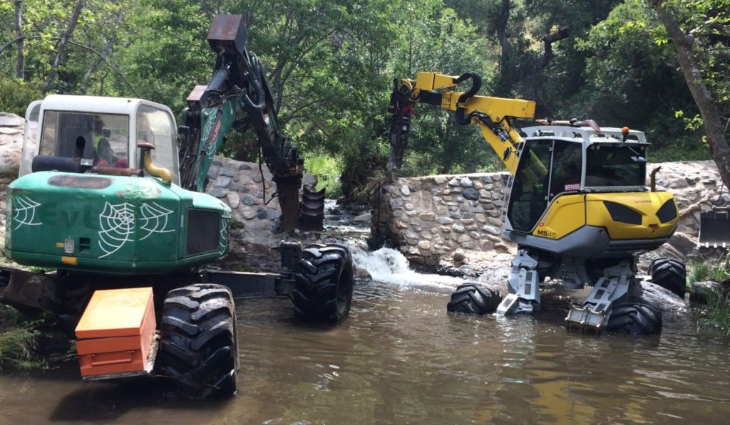 Spider excavators remove on dam on San Juan Creek in California's Cleveland National Forest.